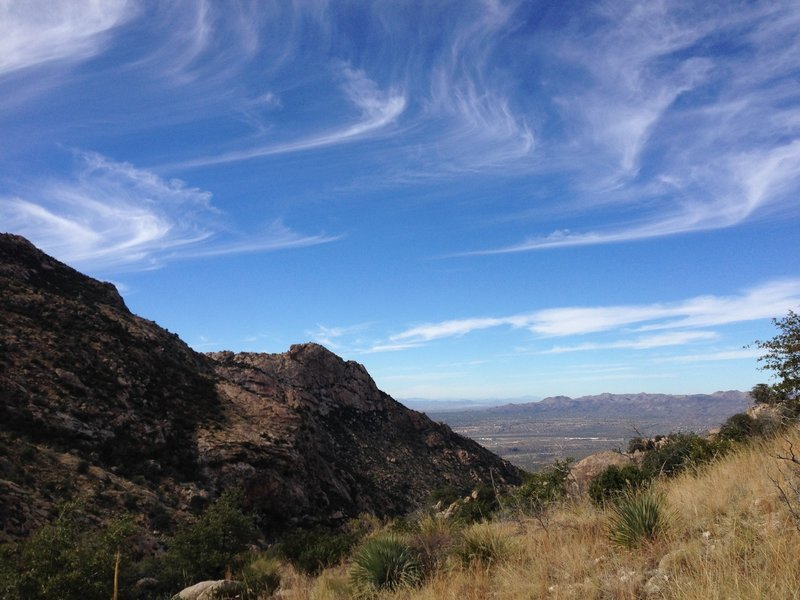 On Romero Canyon trail looking west at Oro Valley, Rancho Vistoso, and Tortolita Mountains.