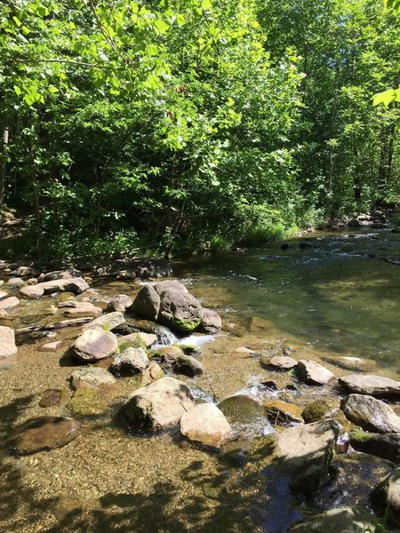 A creek crossing made up of large rocks and boulders.