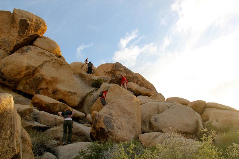 Climbing boulders.