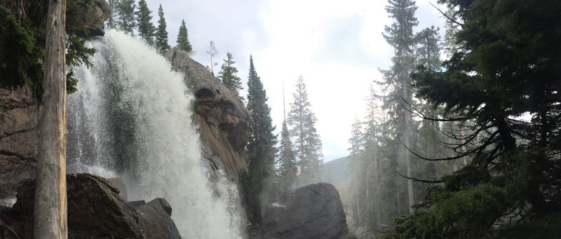 Ouzel Falls, raging, misting visitors as they look at it's majestic wonder.
