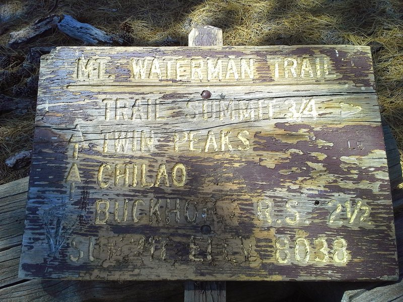 Sometimes the sign is standing, and sometimes it is laying down. By the way, it is Waterman Mountain, not Mt. Waterman.