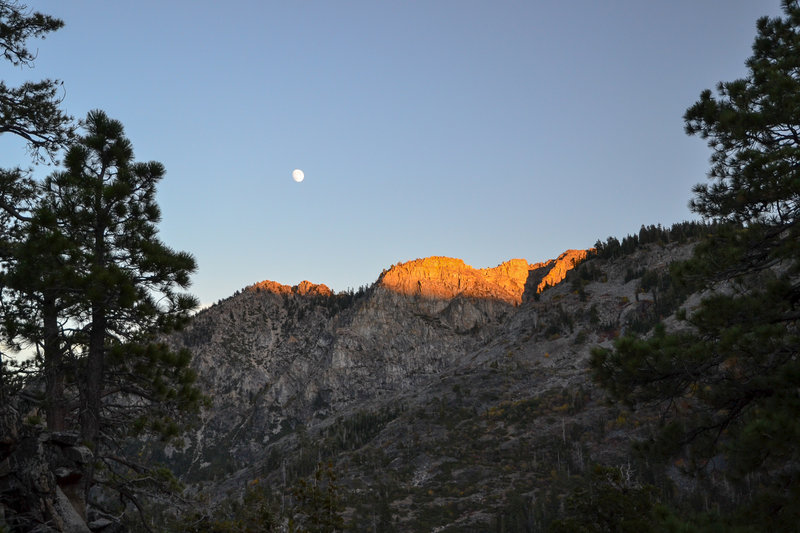 The moon rising over the nearby mountains.