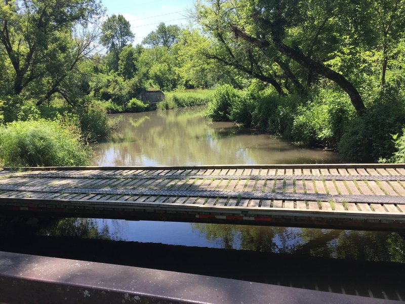 Footbridge on the North Shore Trail over Mill Creek which pours into Lake MacBride.