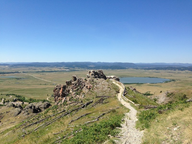 Huge skies, expansive prairie views, and evidence of the 1996 fire are constants on this trail.