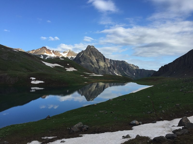 The view across Upper Blue Lake to the Dallas Peak area.