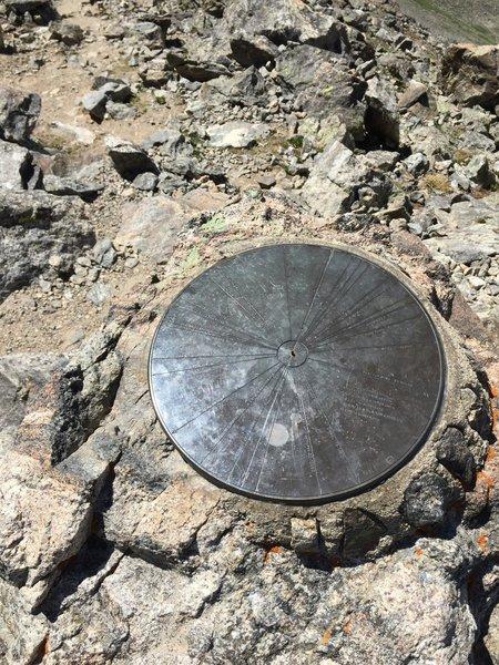 Medallion at the summit.