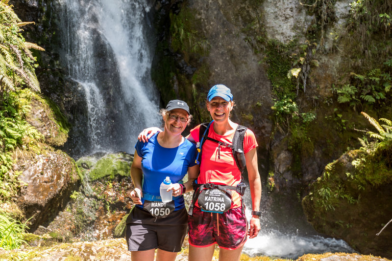 Runners stop below Wairere Falls Buried Village.