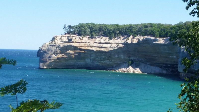 Sandstone cliffs are seen across the water at Pictured Rocks National Lakeshore.