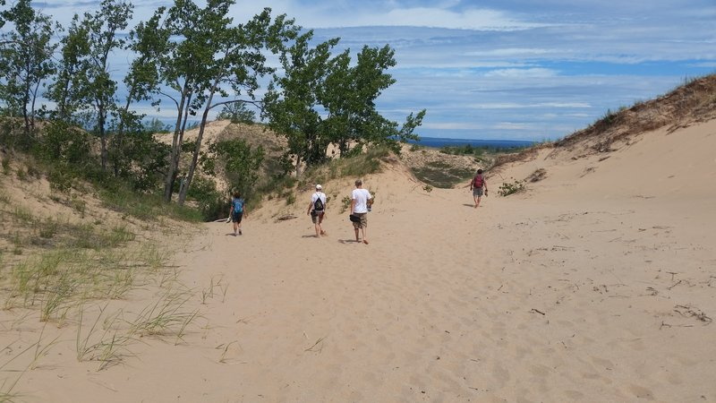 Hiking over sand to Lake Michigan