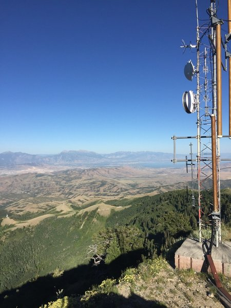 View from summit toward Utah Valley. Utah Lake is visible behind the cell tower.
