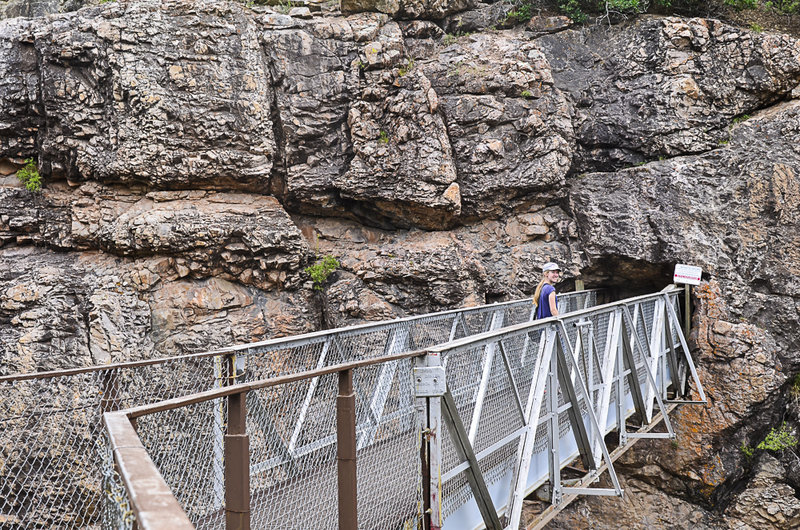 Suspended bridge over Box Canyon Falls fee area, entering the old Ouray water tunnel.