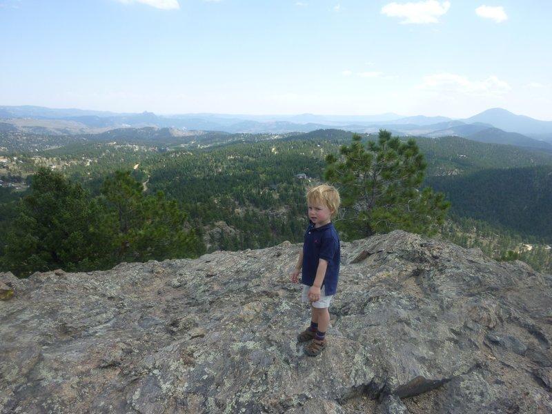 Oscar taking in beautiful summit views.