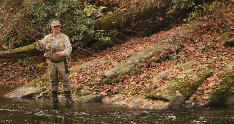A fly fisherman trying to rip some lips on Indian Creek.