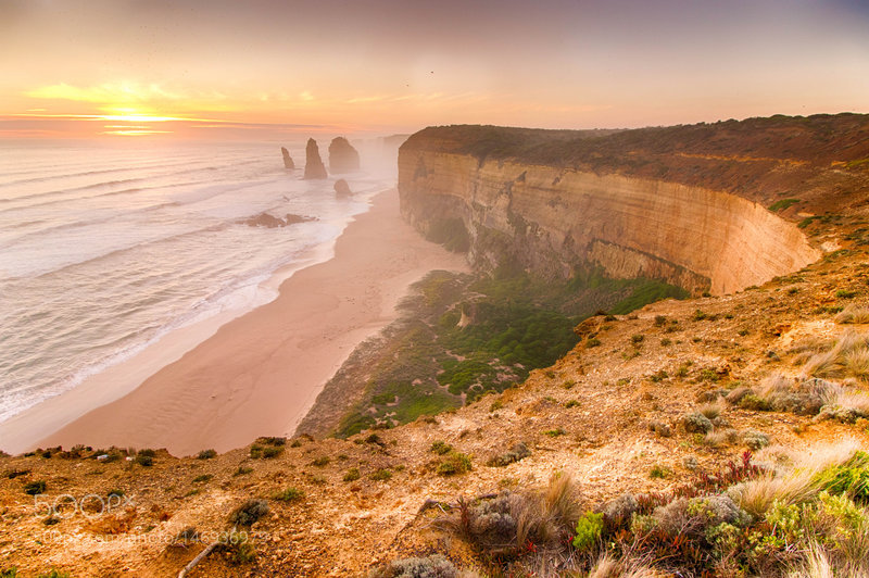 The Twelve Apostles shrouded by ocean spray.