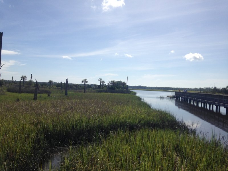 View of the St. John's River from afar as well as the pier from the side.