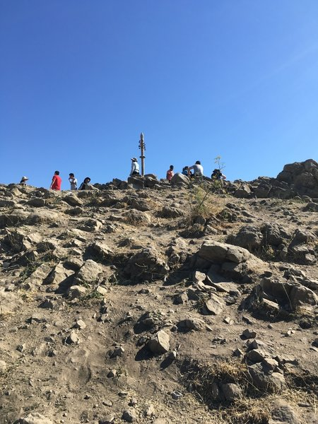 Marker at the peak, and plenty of people enjoying the view!
