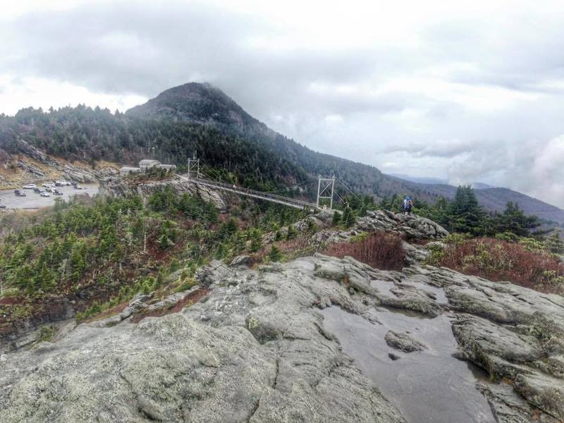 This is MacRae Peak which stands at 5844 feet. in North Carolina. The bridge is exactly one mile above sea level.
