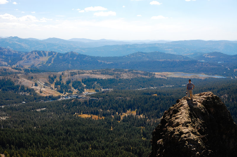 Numerous volcanic ranges ripple away from the southern aspect of Castle Peak.