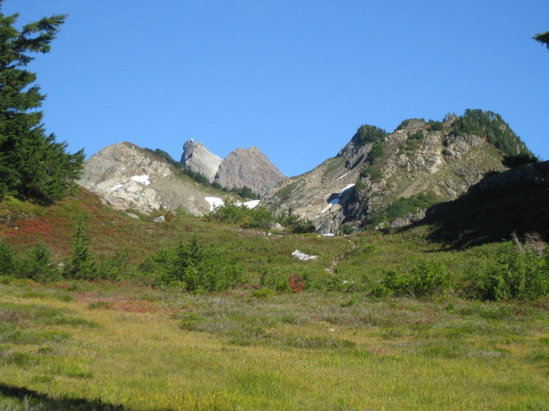 Looking up to the Three Fingers Lookout (middle of 3 left summits) from about Goat Flats.