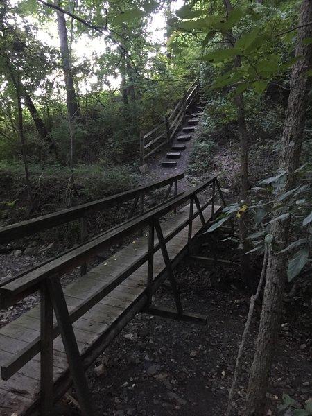 Bridge crossing creek before steep ascent.