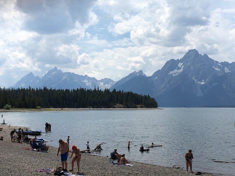 Visitors enjoy Jackson Lake as the Grand Teton defines the horizon.