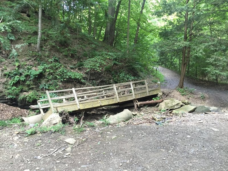 Bridge that has been washed out due to storm.