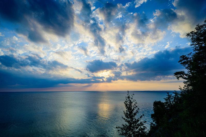 Catching the sunrise on a bluff overlooking Lake Michigan.