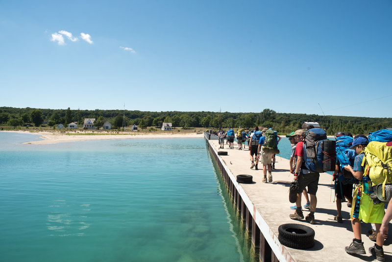 Walking from the Manitou Island Transit ferry onto North Manitou Island.