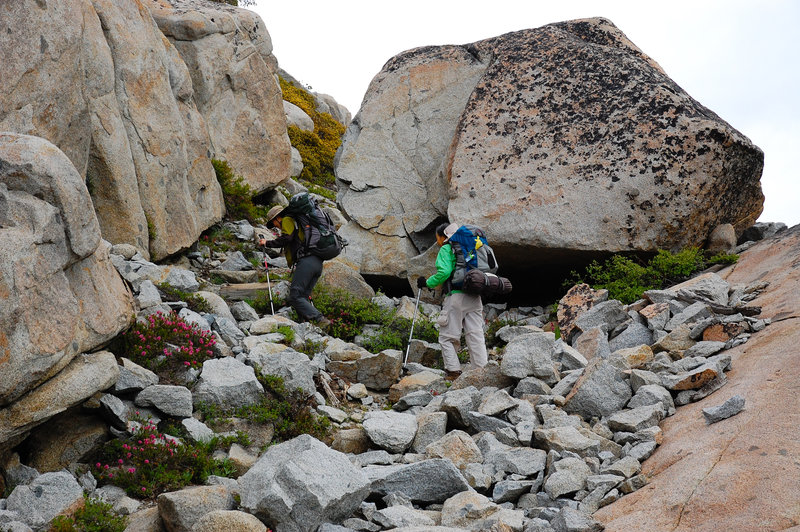 Navigating a rocky section of trail.