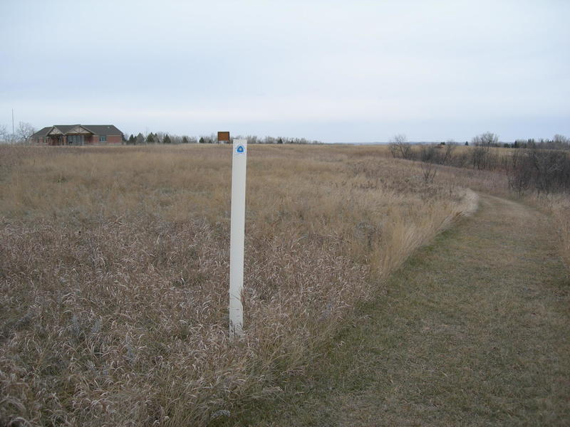 The white posts with the white/blue triangle mark the North Country Trail. For westbound NCT travelers, this is the end.