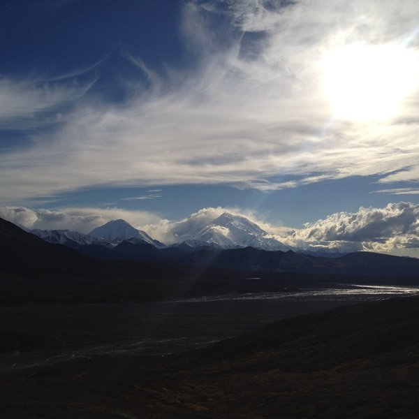 Denali peeks out of the clouds.