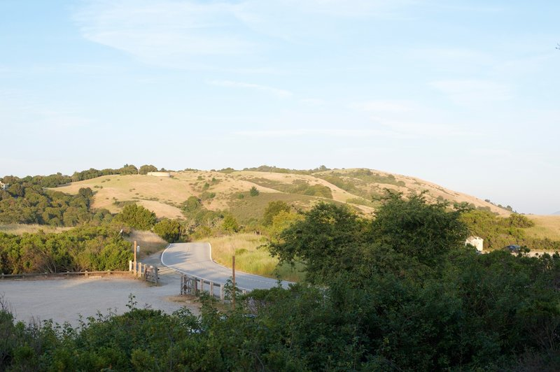 The trail rises above the parking lot offering some of the best views of the Open Spaces in the areas.