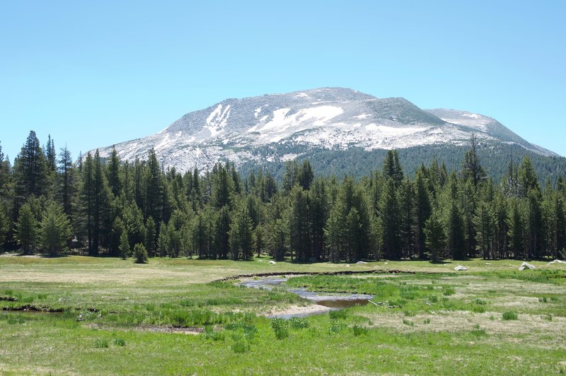 After crossing the road, the trail runs through a meadows with great views of the surrounding mountains.