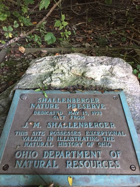 This plaque can be seen from the parking lot.