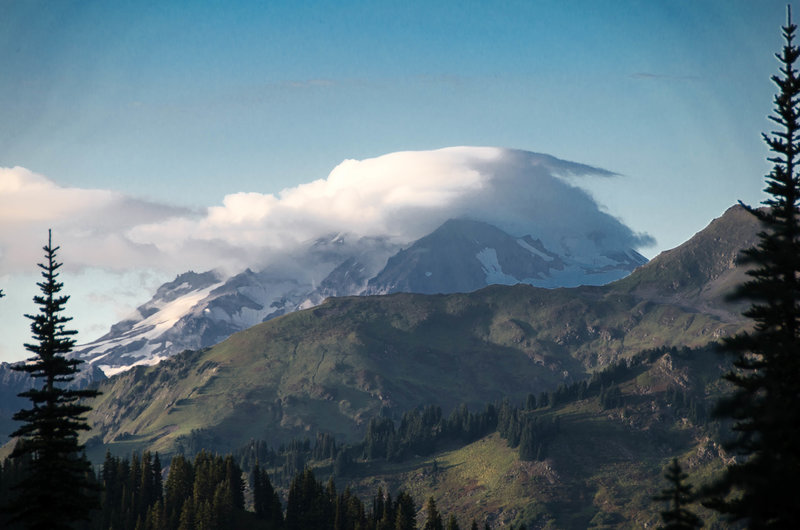View of Glacier Peak wrapped in clouds from Cady Ridge.