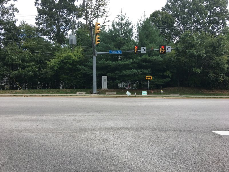 Intersection of Southrun Road and Pohick Road. Cross over to east side of Pohick Road. NOTE: No Cross Walk!