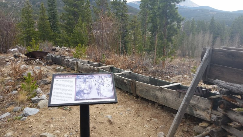 Interpretive sign and sluice box.