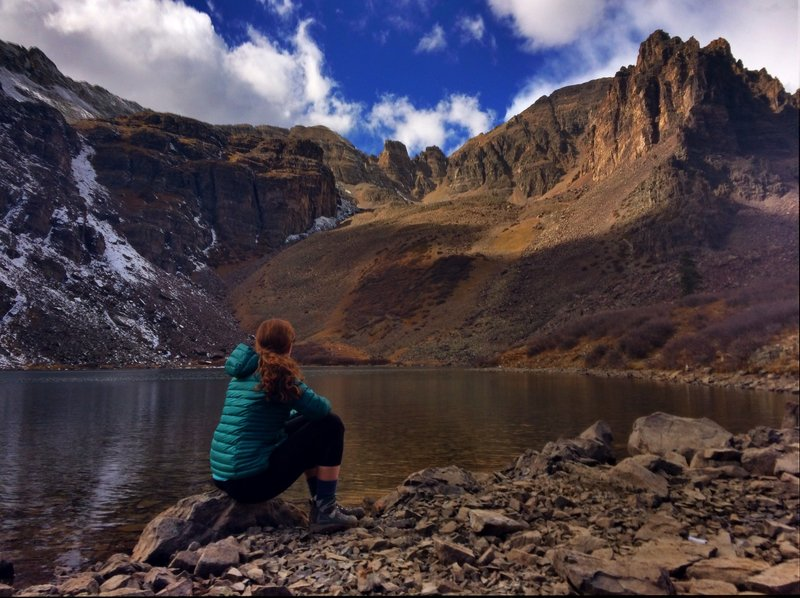 Taking in the view of Cathedral Peak on a peaceful fall day at Cathedral Lake.