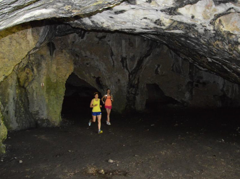 Through one of the numerous caves.