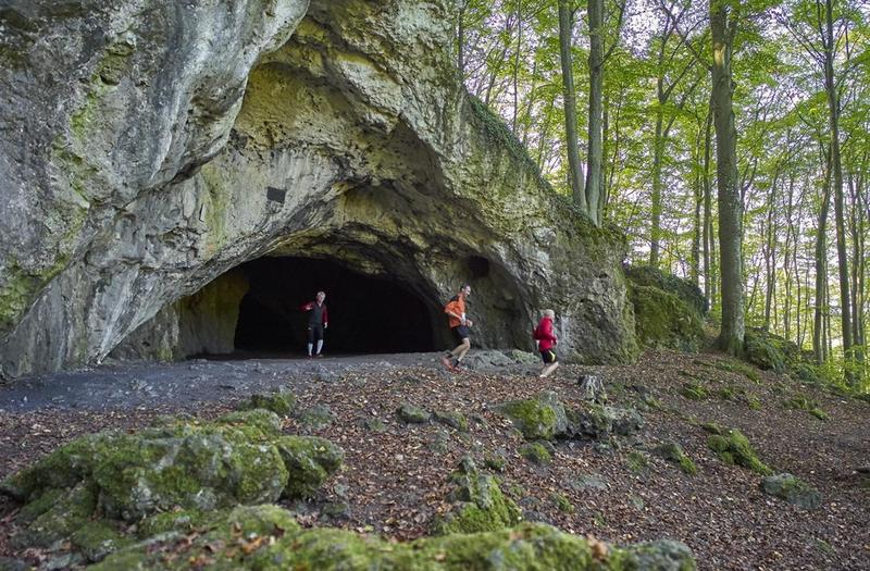 Coming out from the pass-through cave Oswaldhöhle. Photo: Peter Fecher.