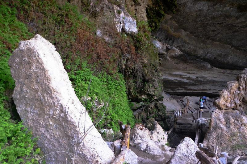 Trail under the overhanging cliffs that round Hamilton Pool