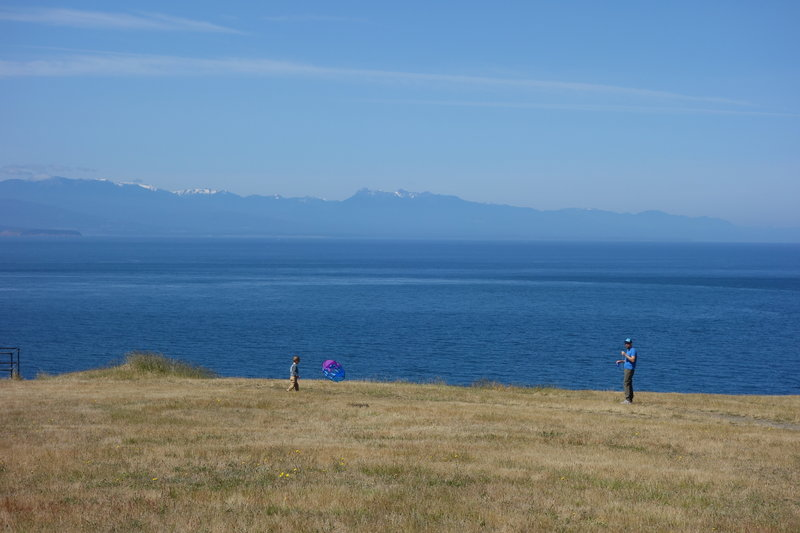 Sunny day at Fort Ebey looking out to the Olympics.  Kites rock!