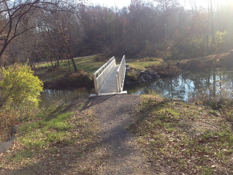 Metal foot bridge over Muddy Creek along North Country Trail.