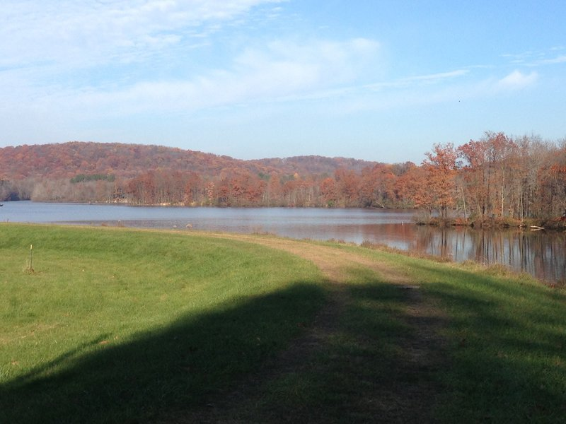 Grass field at the top of the dam along North Country Trail. Great view of Lake Arthur.