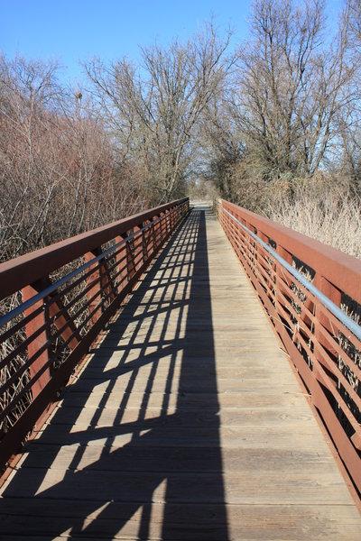 A long bridge on the Lost Slough Wetlands Walk Trail.