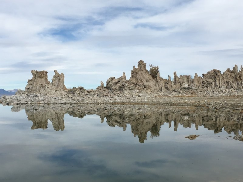 Tufa reflected on the lake.