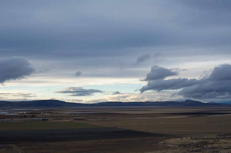 You can get views of the Tulelake National Wildlife Preserve and private lands that are being farmed. You can see the irrigation pattern in the field to the right.