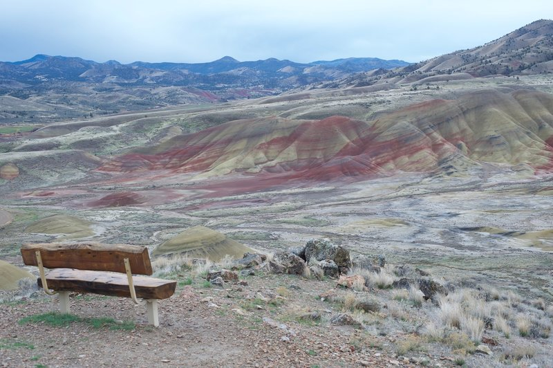 A bench sits off to the right side of the trail, allowing you to take in the views of Painted Ridge and the surrounding hills.