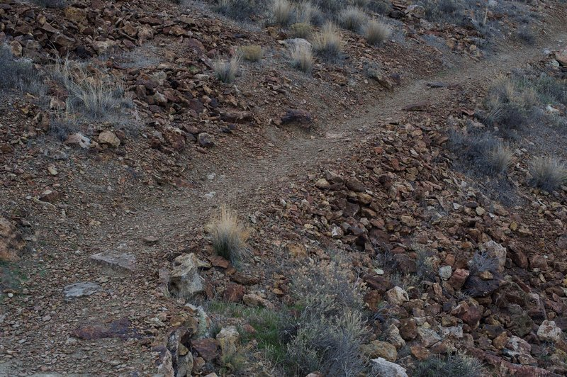 The trail is a mix of gravel, clay and rocks.  This trail is narrow, so take care passing other hikers.