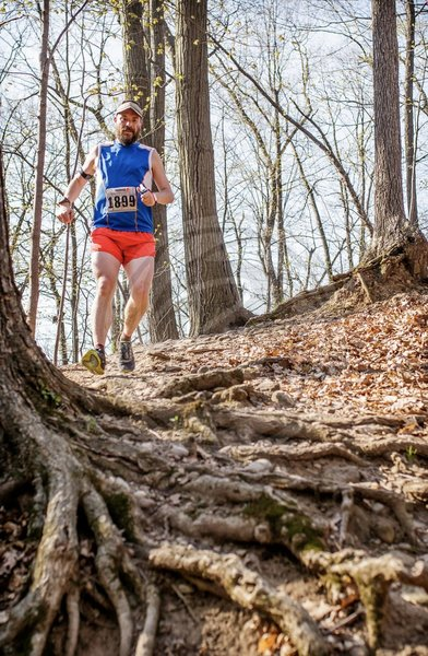 Chris O'Brien from the Running Inside Out Podcast bombing the downhills at Medved Madness Trail Run. (Photo by Ron Heerkens Jr Photography.)